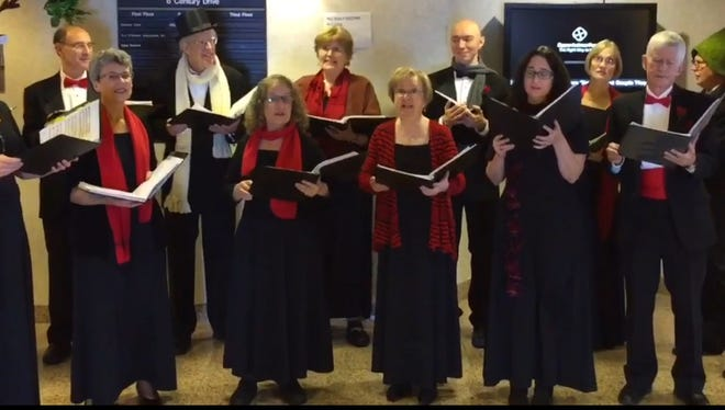 Harmonium Choral Society performs at Daily Record on Friday, Dec. 4, 2015.