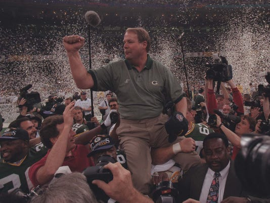 Coach Mike Holmgren salutes the crowd and pumps his fist in the air after the Packers became Super Bowl champions. Credit: