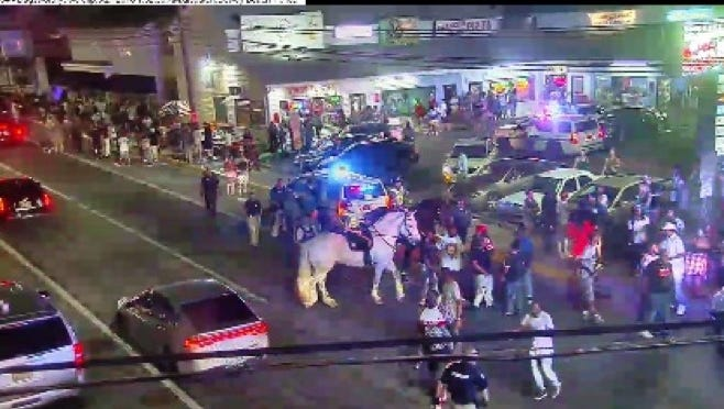 As officers attempted to arrest an individual, a large crowd formed Sunday morning in Dewey Beach, police said.