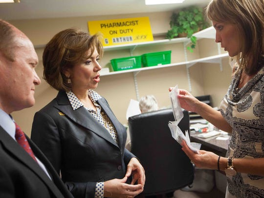Maria Contreras-Sweet (center), head of the U.S. Small Business Administration, talks with Christy L. Crkvenac, president of Fulcrum Pharmacy Management Inc., as Sen. Chris Coons listens Tuesday.