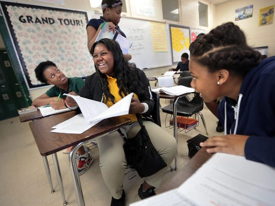 Eighth graders Paris Taylor (left), Andria White, and