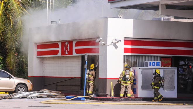 Smoke bellows from the side of the Agat Circle K/76 as Guam Fire Department firefighters douse a fire within the building on Wednesday, July 8.