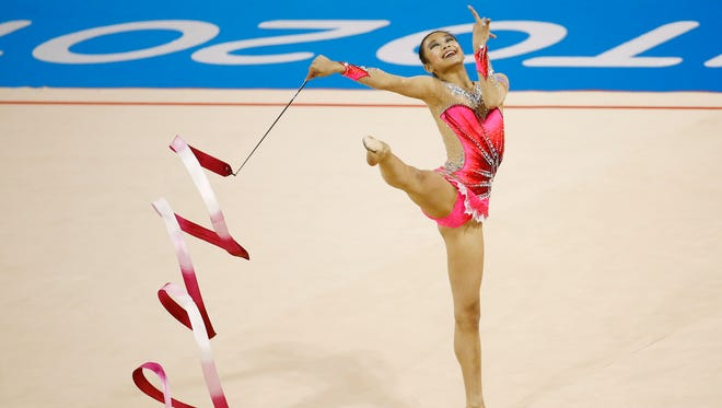 Laura Zeng of the United States competes in the rhythmic gymnastics ribbon final during the 2015 Pan Am Games at Toronto Coliseum on July 20, 2015.