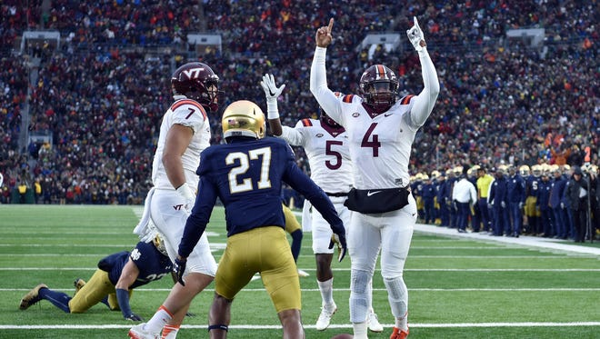 Virginia Tech Hokies quarterback Jerod Evans (4) celebrates after scoring a touchdown in the second quarter against the Notre Dame Fighting Irish at Notre Dame Stadium.