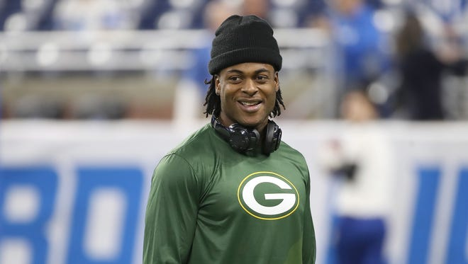 Green Bay Packers wide receiver Davante Adams (17) smiles as he walks on the field before the game against the Detroit Lions on Dec. 31, 2017, at Ford Field in Detroit.