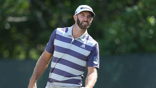 Dustin Johnson reacts to his tee shot on the second hole during the third round of the U.S. Open golf tournament at Shinnecock Hills.