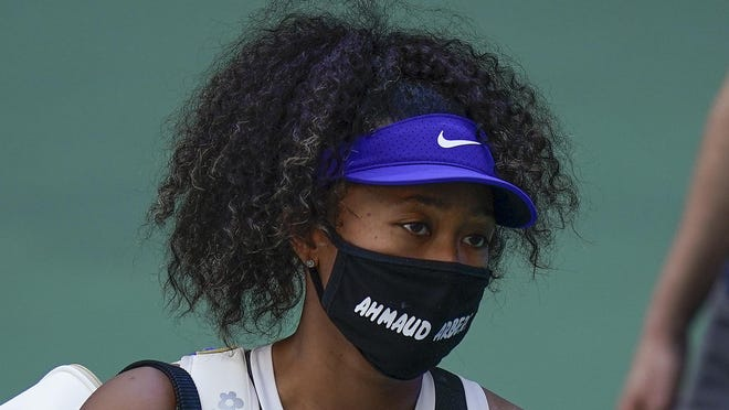 Naomi Osaka, of Japan, walks off the court after winning a match against Marta Kostyuk, of the Ukraine, during the third round of the US Open tennis championships, Friday, Sept. 4, 2020, in New York.