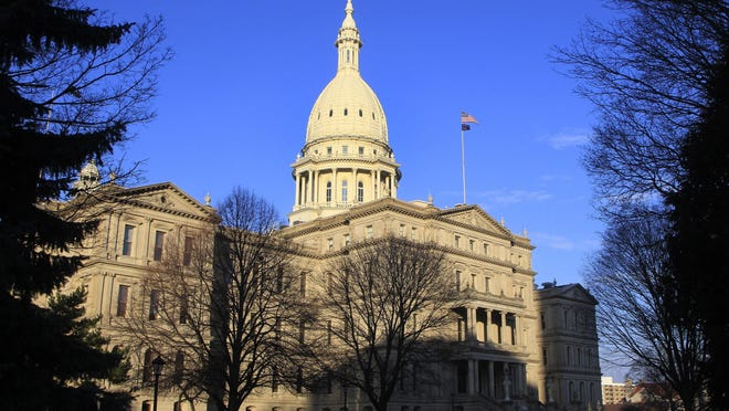 This Dec. 12, 2012 file photo shows the state capitol building in Lansing, Mich. Michigan State Police arrested a man Thursday in connection with a bomb threat at the Michigan Capitol, the state Attorney General's office said in a release.