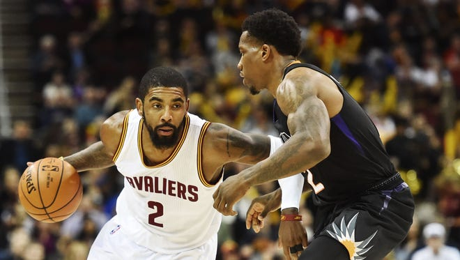Cleveland Cavaliers guard Kyrie Irving (2) drives to the basket against Phoenix Suns forward TJ Warren (12) during the first quarter at Quicken Loans Arena.