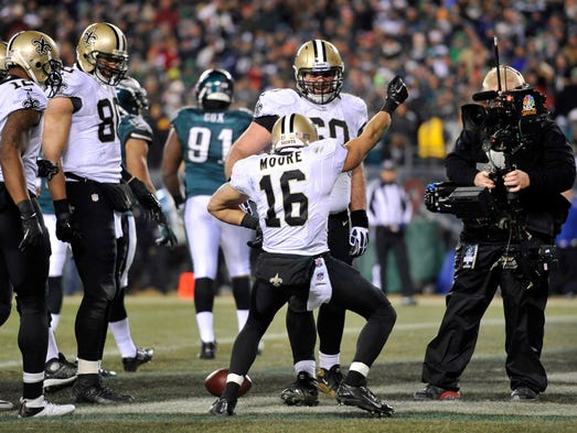 New Orleans Saints wide receiver Lance Moore (16) celebrates a touchdown catch against the Philadelphia Eagles during the second half of the 2013 NFC wild card playoff football game at Lincoln Financial Field.