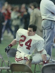 Alabama full back Kevin Turner (24) sits in the bench area during the Iron Bowl at Jordan-Hare Stadium in Auburn, Ala., on Dec. 2, 1989.
