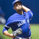 Toronto Blue Jays starting pitcher David Price throws against the Minnesota Twins during the first inning of a baseball game in Toronto on Monda. (Fred Thornhill/The Canadian Press via AP)