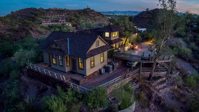 An 1898 train depot hauled up a Phoenix mountain by a former Arizona Highways Magazine editor to create a home is now on the market for $1.05 million.