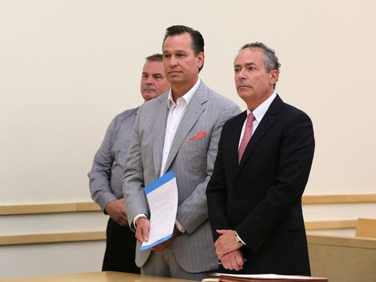 Richard Brega, center, with attorney Kerry Lawrence,