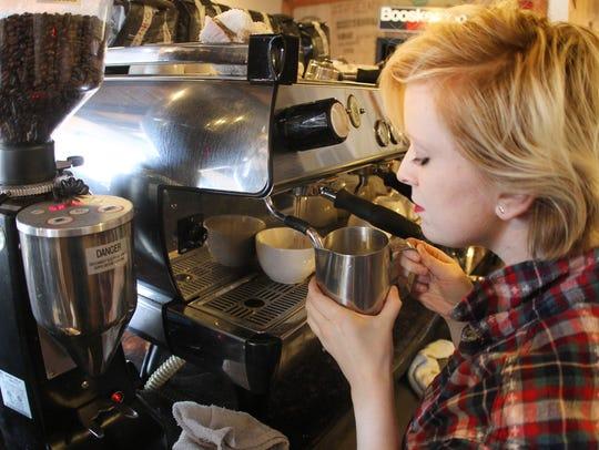 Kaitlyn Kurkemelis makes a espresso latte at Booskerdoo's
