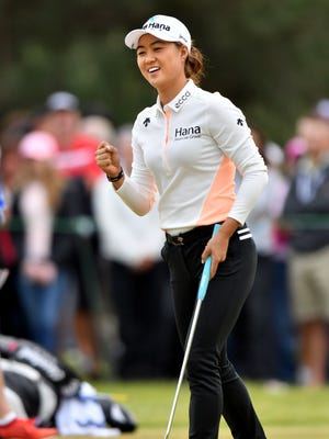 Minjee Lee pumps her fist and grins as she sinks her birdie putt on the ninth hole Friday.