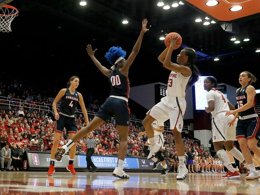 Stanford guard Kiana Williams (23) takes a shot over Gonzaga forward Zykera Rice (00) during the second half of a first-round game in the NCAA women's college basketball tournament in Stanford, Calif., Saturday, March 17, 2018. Stanford won 82-68. (AP Photo/Tony Avelar)