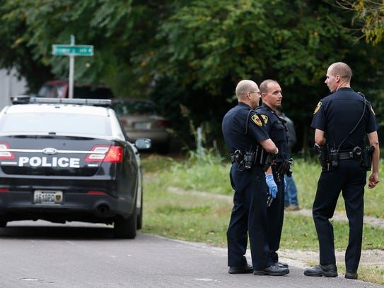 Police investigate the scene where a dog was shot and