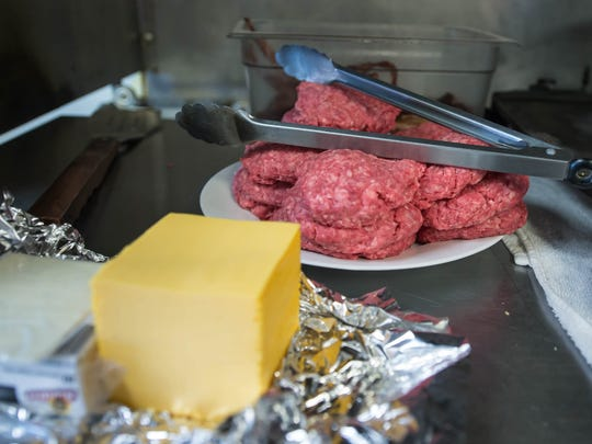 Meat and cheese await the grill at Cereal City Burgers.