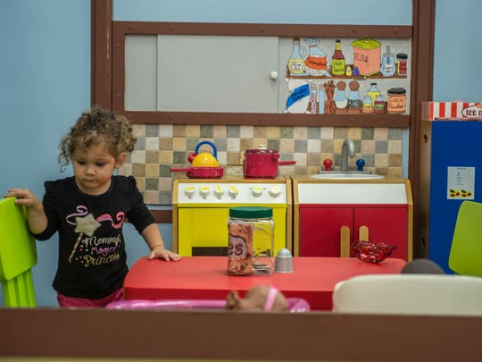 Two-year-old Evelyn Gillern from Albion plays in a play house at Kids 'N' Stuff in downtown Albion in 2015.