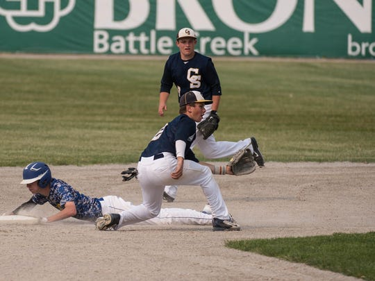 Climax-Scotts' Ethan Vosburg get the throw during the Division 4 state quarterfinal held at C.O. Brown on Tuesday.