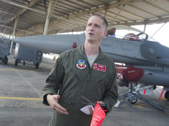 Col. Randy Efferson stands next to his F-16 on Wednesday.