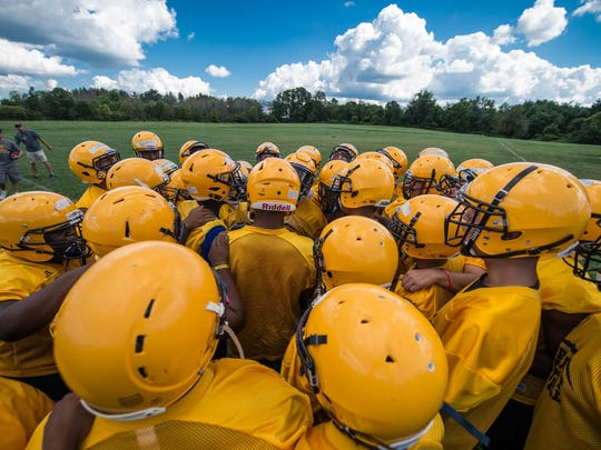 Battle Creek Central football players fire up before practice during football camp at Clear Lake Camp.