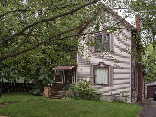 The home at 64 S. Union St. in Battle Creek is one of 242 properties up for auction next week.