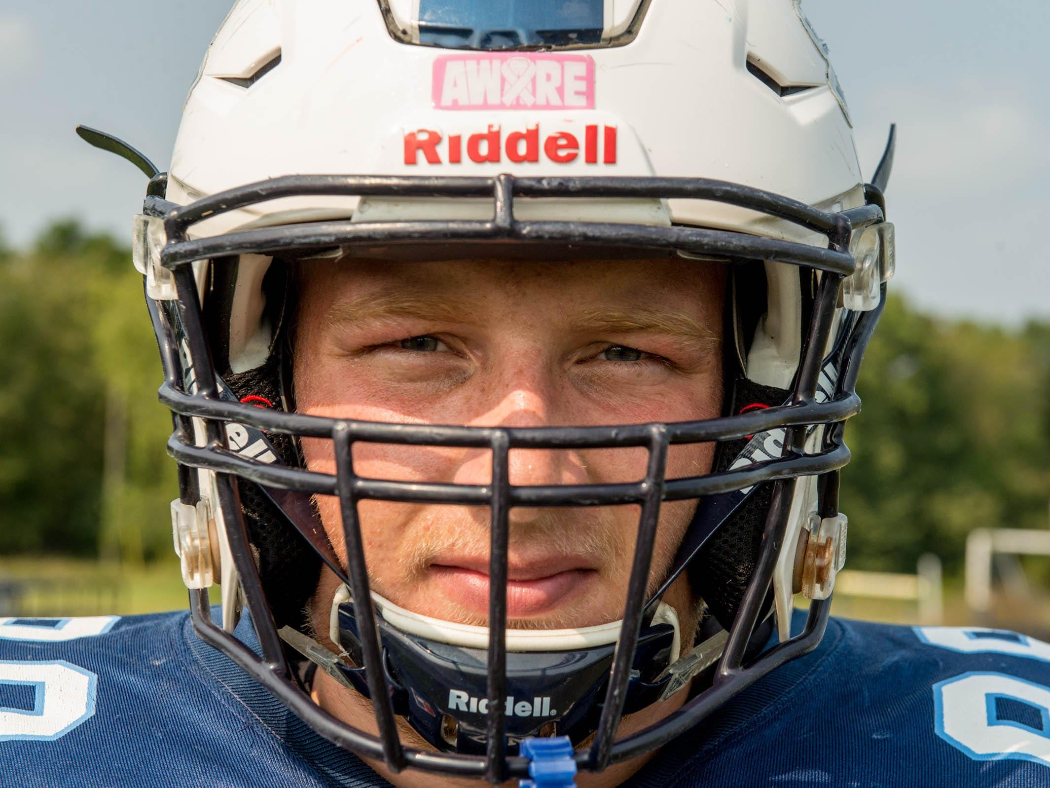 Maple Valley senior Marcum Terpening with new helmet with sensors built in to help avoid concussions.