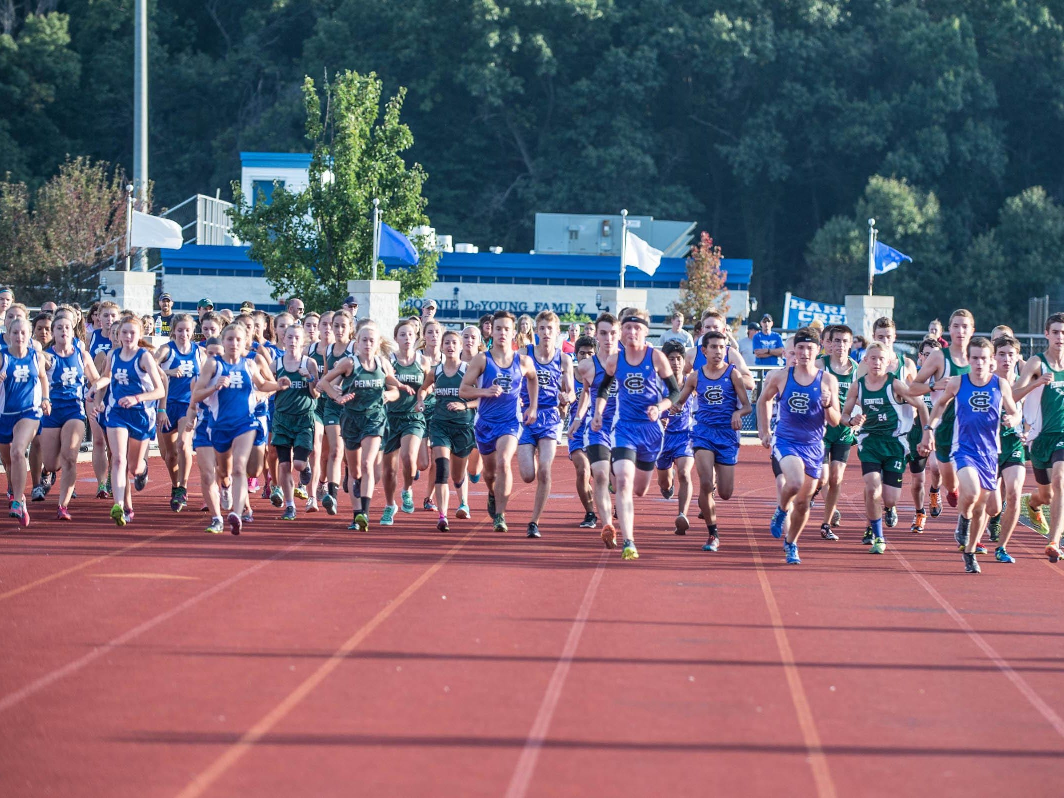 Harper Creek and Pennfield runners at the start of the cross country meet at Harper Creek Friday.