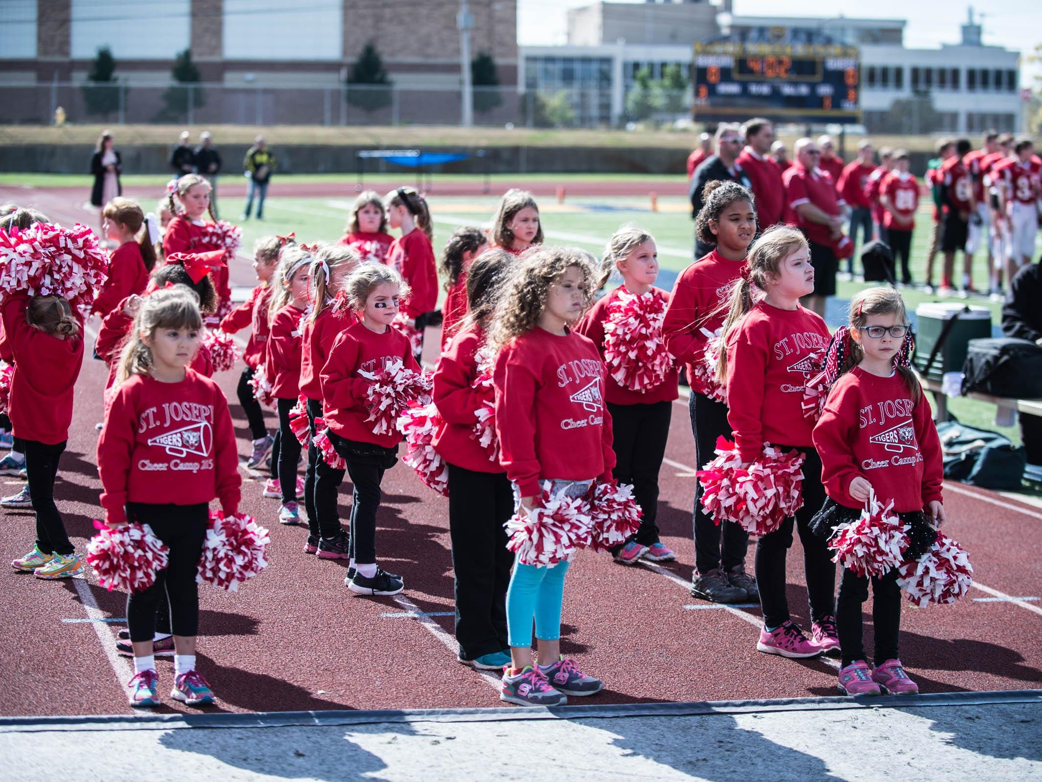 Cheerleaders from St. Joseph Elementary get the crowd fired up during St. Philip's Homecoming game on Saturday.