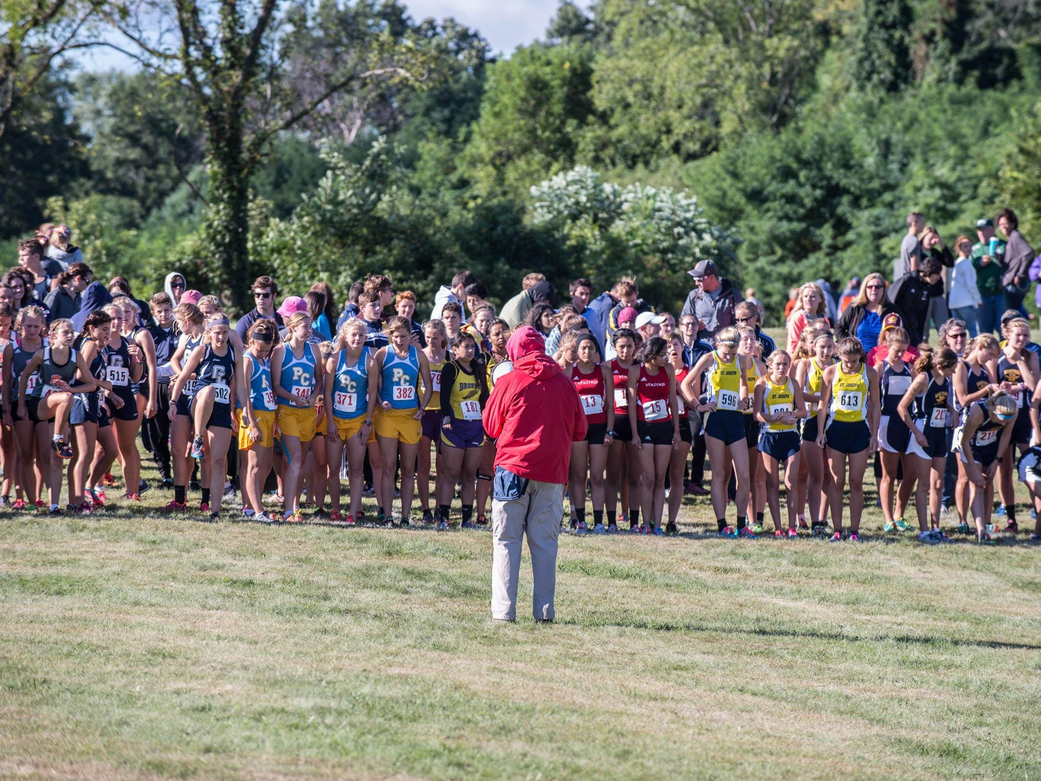 Runners gather at the starting line for the Lakeview Invitational on Sept. 12.