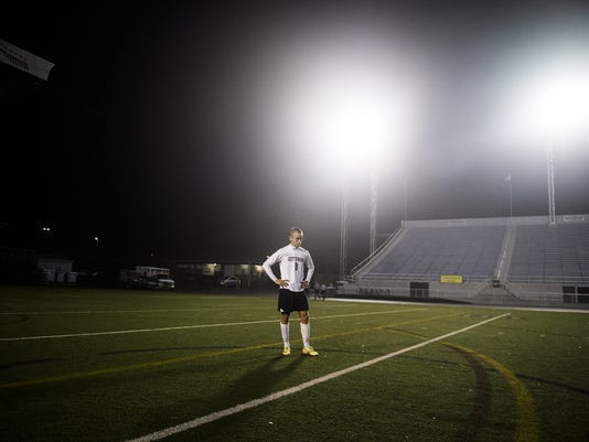 Gettysburg's Matt Yingling stands on the field at Hersheypark Stadium after his team suffered a 2-1 loss to Lancaster Mennonite on Thursday in the District 3 Class AA boys' soccer championship.
