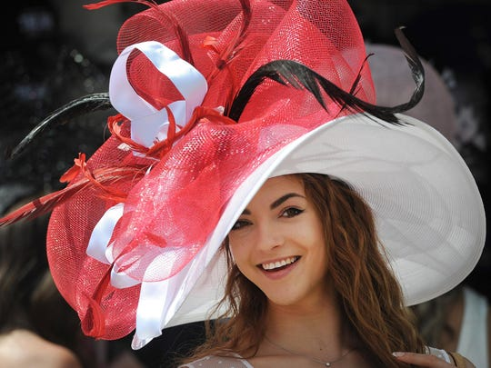 May 7, 2016; Louisville, KY, USA; Monique Rosteing poses with her derby hat before the 142nd running of the Kentucky Derby at Churchill Downs. Mandatory Credit: David Lee Hartlage/Louisville Courier-Journal via USA TODAY NETWORK