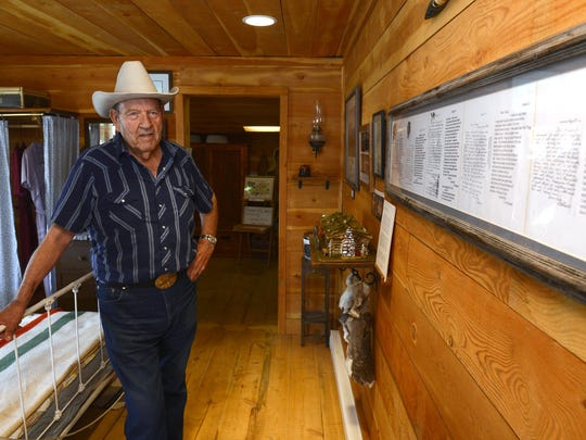 Gene Dwyer stands in the Charlie and Nancy Russell Honeymoon Cottage in Cascade on Monday. Dwyer restored the cottage to its original state and offered tours by reservation.