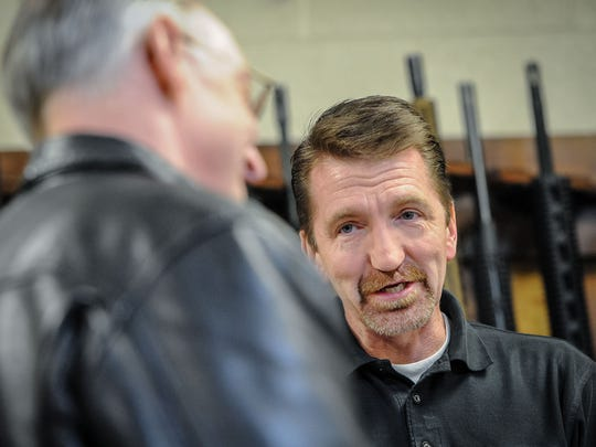 Dave Larsen, right, speaks with Robert Miska, MD, about selling handguns at Doug's Shoot'n Sports in Taylorsville on Tuesday, April 17, 2018.