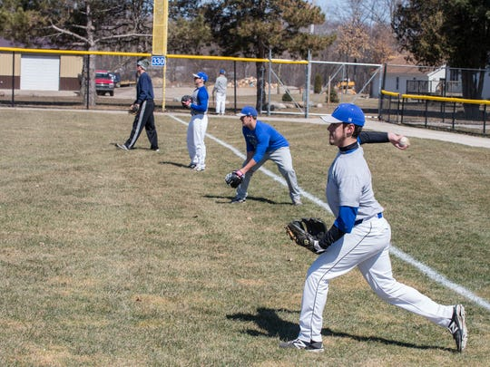 KCC baseball players warm up during a recent practice.