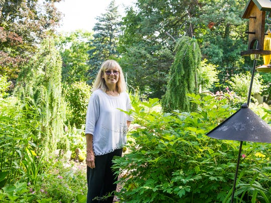 Teddy Carr of Penfield prefers to maintain her home's gardens organically and naturally.