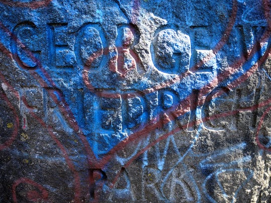 Graffiti covers the engraved sign Wednesday at the entrance to Friedrich Park in St. Cloud.