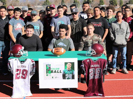 The entire Tularosa High School football team posed for a picture alongside Caleb Ball during his signing ceremony.