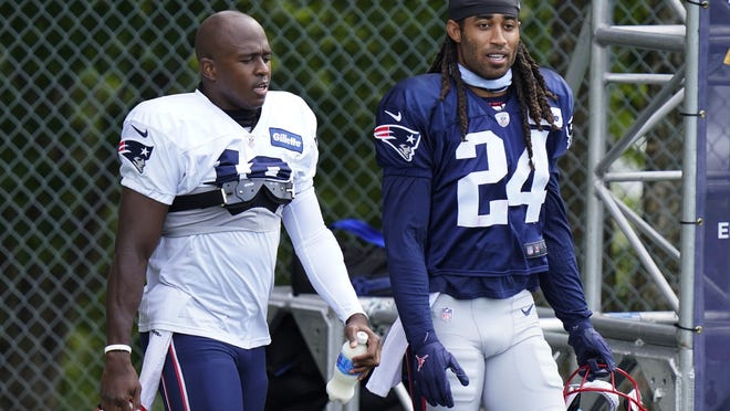 Patriots cornerback Stephon Gilmore, right, returned to training camp Tuesday at Gillette Stadium.