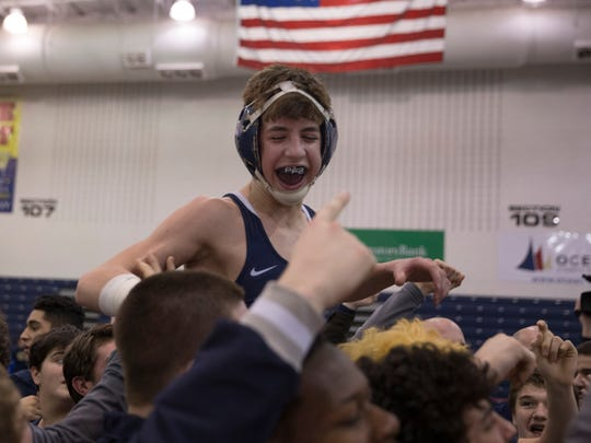 Howell's Luke Rada is lifted in the air as Howell celebrates their Group V title. Hunterdon Central vs Howell for NJSIAA Public  Group V Team Wrestling Championship  in Toms River, NJ on February 12, 2017