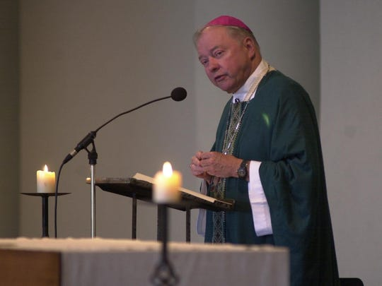 Bishop John F. Kinney spoke during a noon service at St. Mary's Cathedral in 2001.