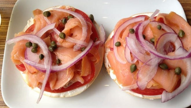 Taste Café & Marketplace, 5164 N College Ave: This one comes ready-made and open-face, with cream cheese, tomato, red onion, capers, lox. $10