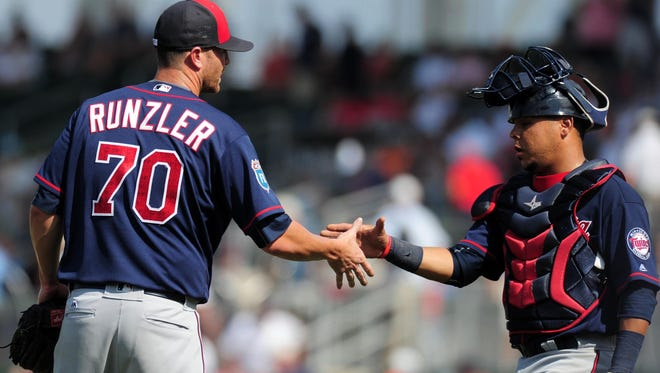 Catcher Juan Centeno was congratulating Dan Runzler after he closed out the Minnesota Twins' 8-6 win over the Boston Red Sox in spring training on March 18, but on Wednesday the Rochester Red Wings said goodbye to the 31-year-old reliever.