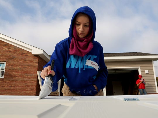 In 2014, Brianna Isobski of Dearborn was one of the volunteers who came to work on a Habitat for Humanity home on Hartwell Street in Detroit during Make a Difference Day.
