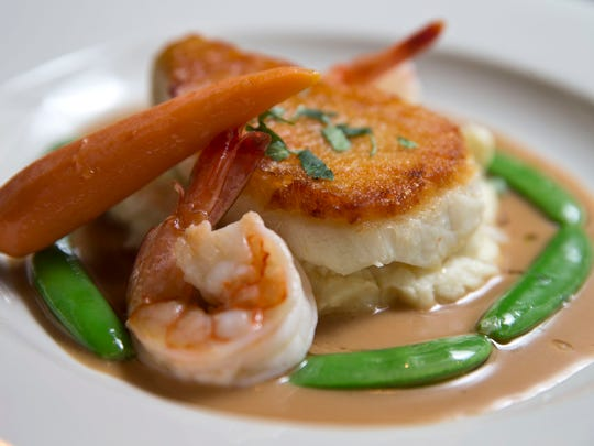 Chef Christopher Atamian's pan-seared Chilean sea bass over potato parsnip puree with sugar snap peas and butter-braised shrimp.