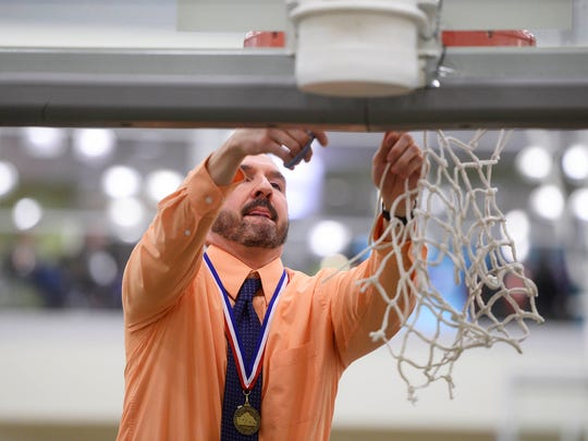 William Penn head coach Troy Sowers cuts the net after the Bearcats won the 2015 YAIAA boys' basketball tournament championship. Sowers announced Thursday that he will resign after 10 years at the Bearcats helm.