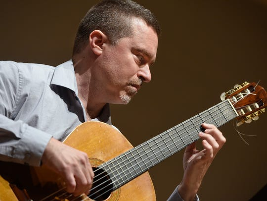 Guitarist Jesse Langen performs while rehearsing with
