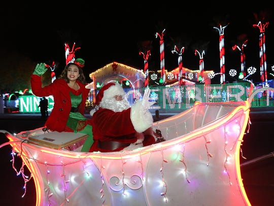 Santa Claus and his elf rode up and down the street outside the Fred Loya home in East El Paso last year.